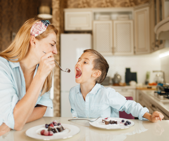 mom feeds son a yummy gluten free meal.
