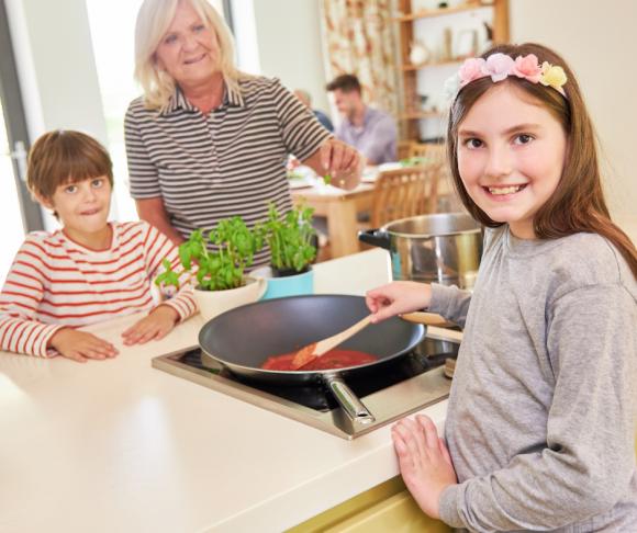 girl cooks gluten-free meal for family
