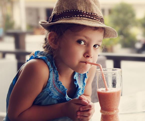 girl tastes a gluten free drink