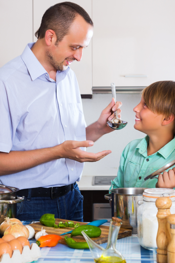 boy taste tests his father's gluten free cooking.
