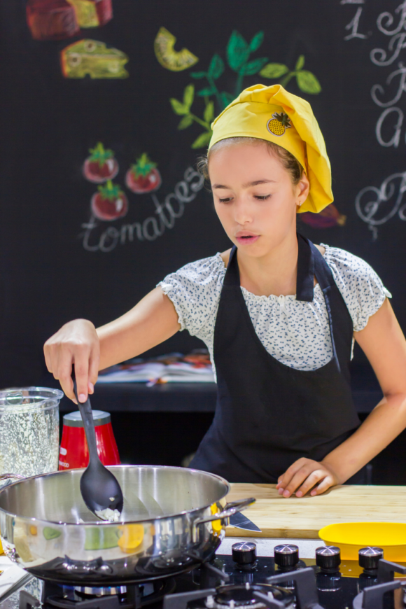 girl cooking in the kitchen to test gluten-free foods for kids.