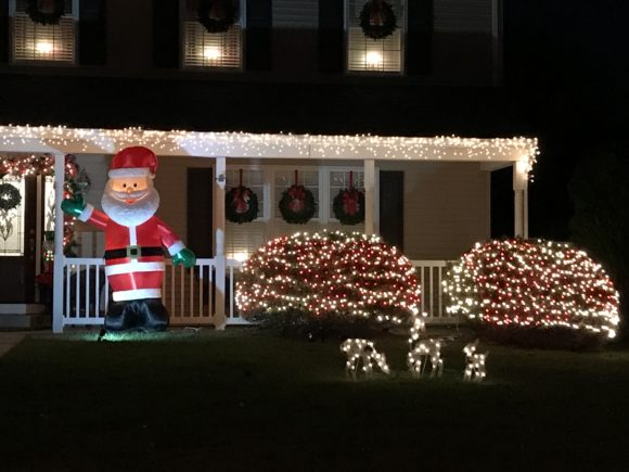 Christmas lights and inflatable Santa on Twin Ponds Drive in Washington Township, New Jersey.