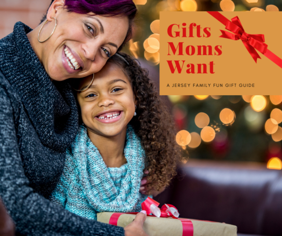 mom and daughter post with gifts near tree - gifts moms want gift guide