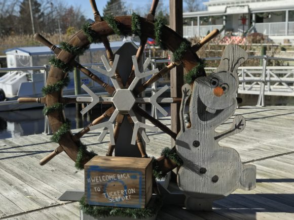 olaf and a decorated ship wheel at the tuckerton seaport