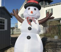 an inflatable snowman greets guests at the Tuckerton Seaport