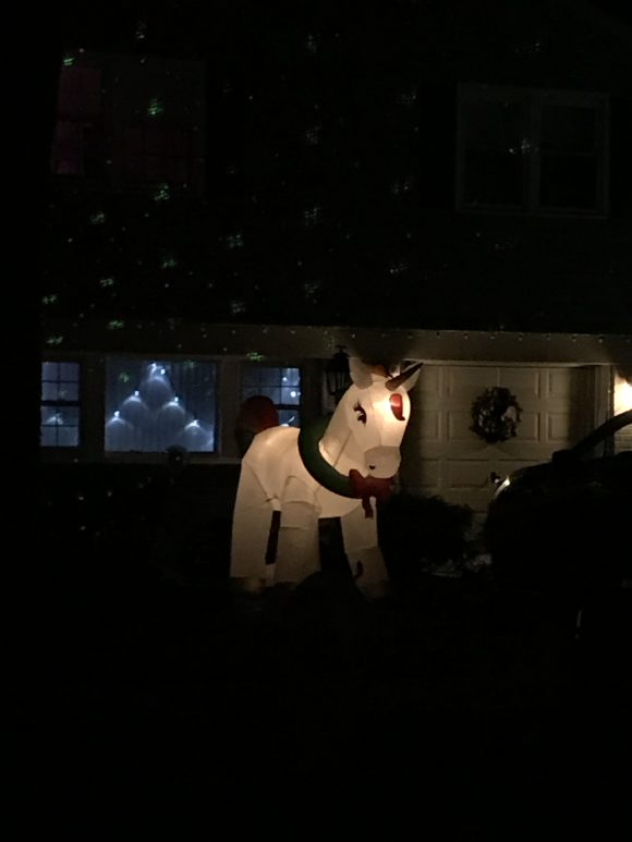 Inflatable unicorn is part of a holiday display on Bells Lake Drive in Washington Township.