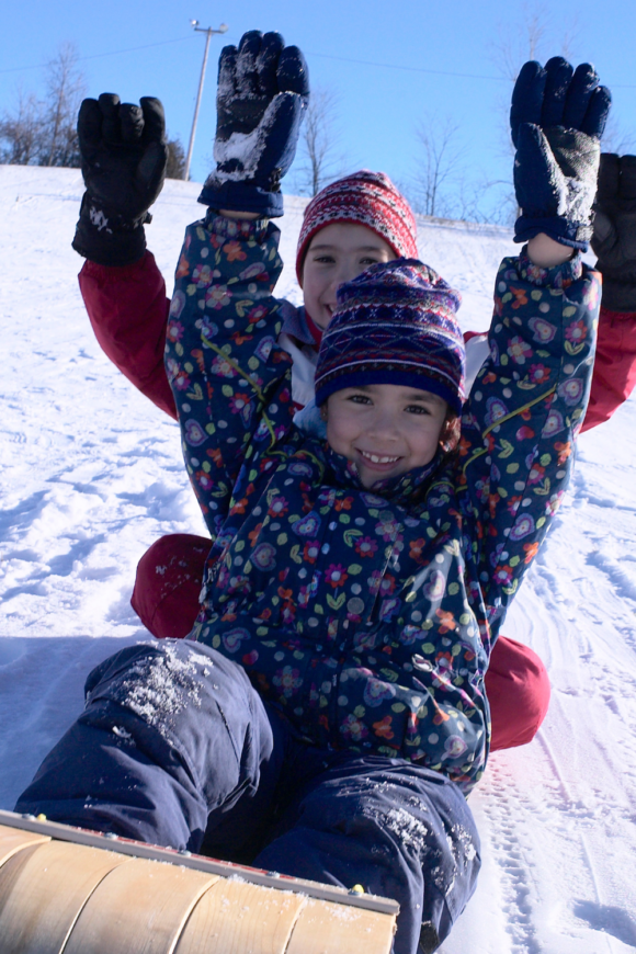 2 kids on a sled