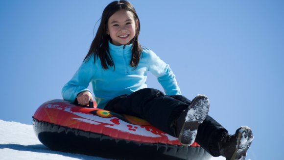 An Asian girl is now tubing on a hill in South Jersey