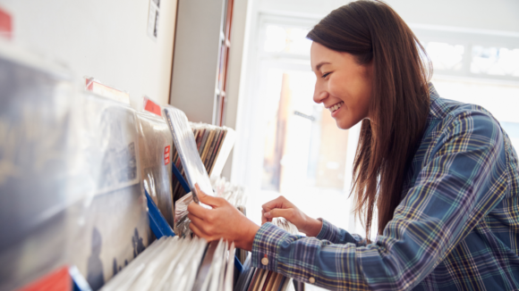 girl buys records in New Jersey at record shop