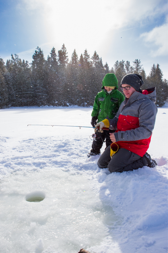 father and son ice fishing in New Jersey