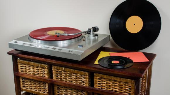 record player on stand with records