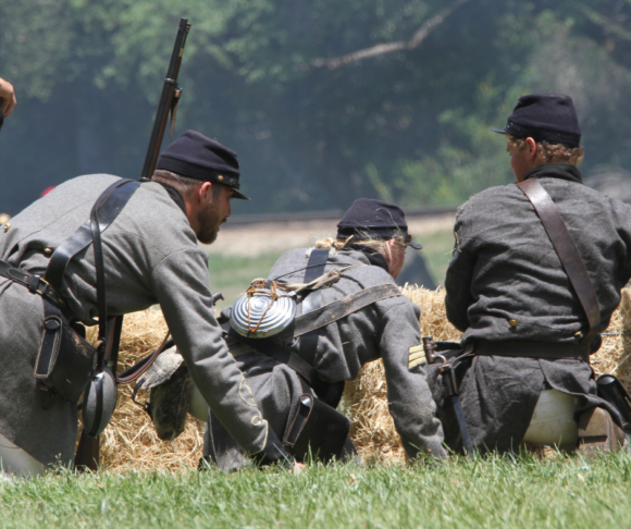 a civil war reenactment takes place in a park
