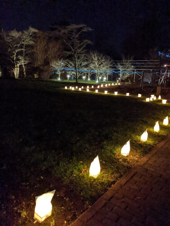 luminaries light the way at the Historic Smithville park candlelight holiday village tours.