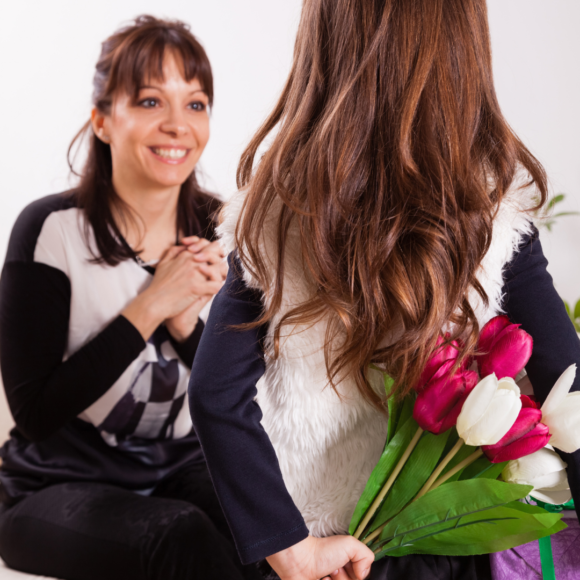 a daugher surprises her mom with a gift.png