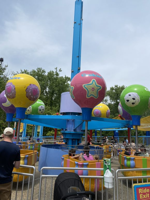toddlers and preschoolers at sesame place enjoy the Flying Cookie Jars ride.