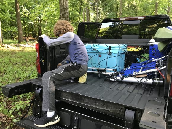 2021 Chevy Silverado at Stokes State Forest boy works to unload truck
