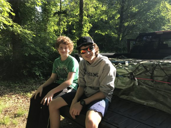 2021 Chevy Silverado at Stokes State Forest boys sit on the back of the pick up bed