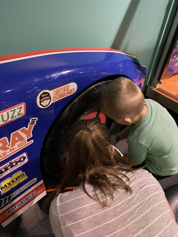 A sister and brother work on a Hot Wheels car at Liberty Science Center
