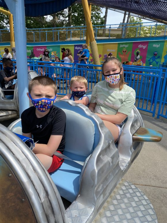 toddlers and preschoolers enjoy the Oscar's Rotten Rusty Rockets at Sesame Place with older siblings.