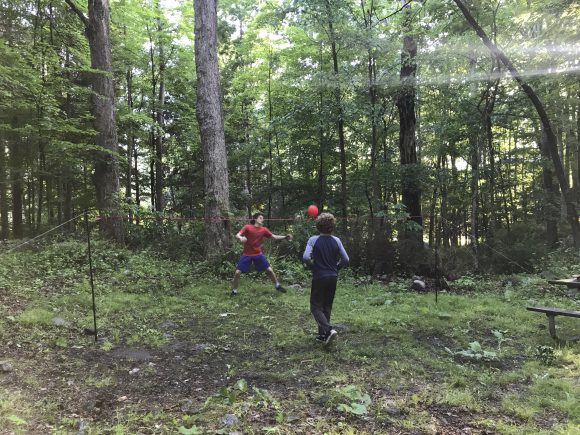 boys play volleyball at Stokes State Forest campsite