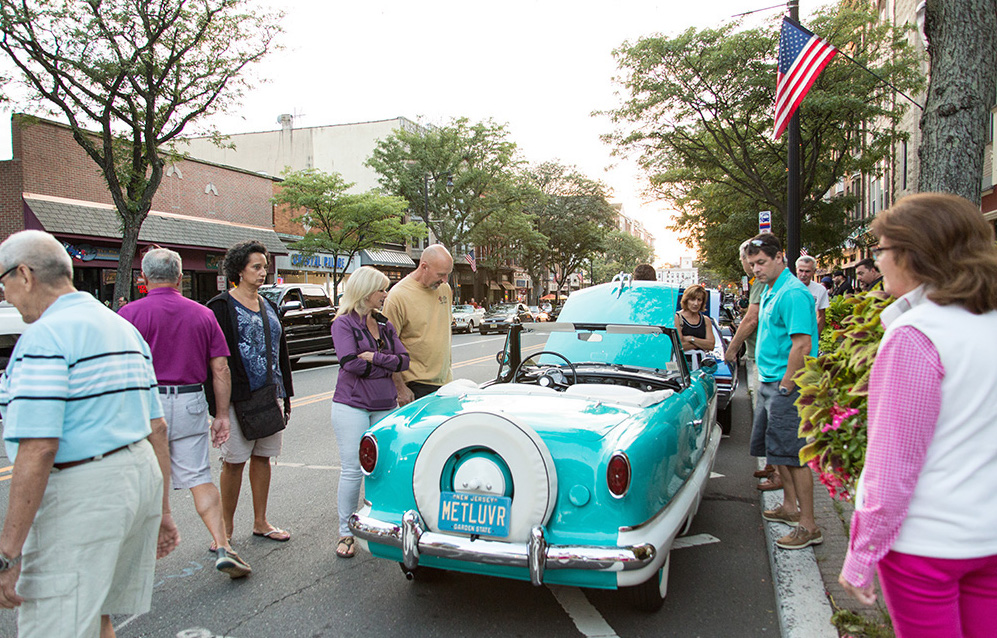 crowds enjoy the classic cars at the Downtown Somerville Cruise Nights