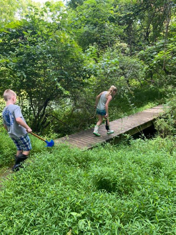 Big Brook Preserve kids walking along a wooden bridge