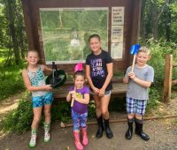 Big-Brook-Preserve-kids-with-park-map-and-dinosaur-fossil-digging-tools