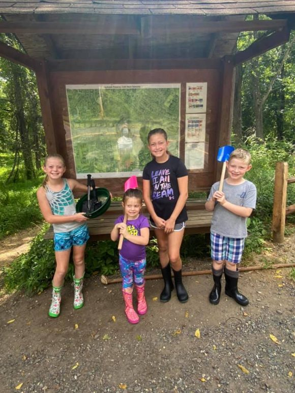 At Big Brook Reserve in NJ a family is ready to collect dinosaur fossils.