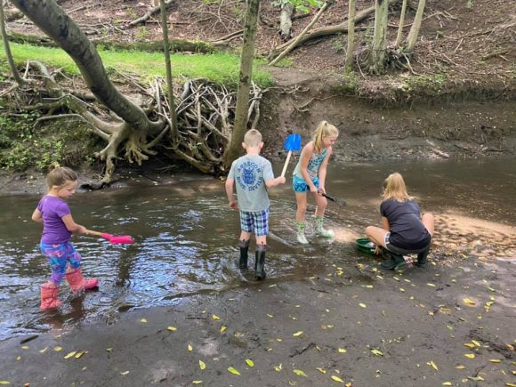 Big Brook Preserve sifting through the mud to find dinosaur fossils