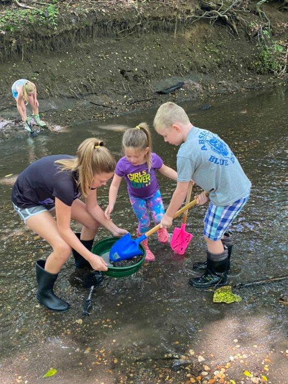 at Big Brook Preserve family works together to find dinosaur fossils