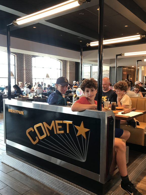 family picture in comet booth at The Chocolatier at Hershey Chocolatown