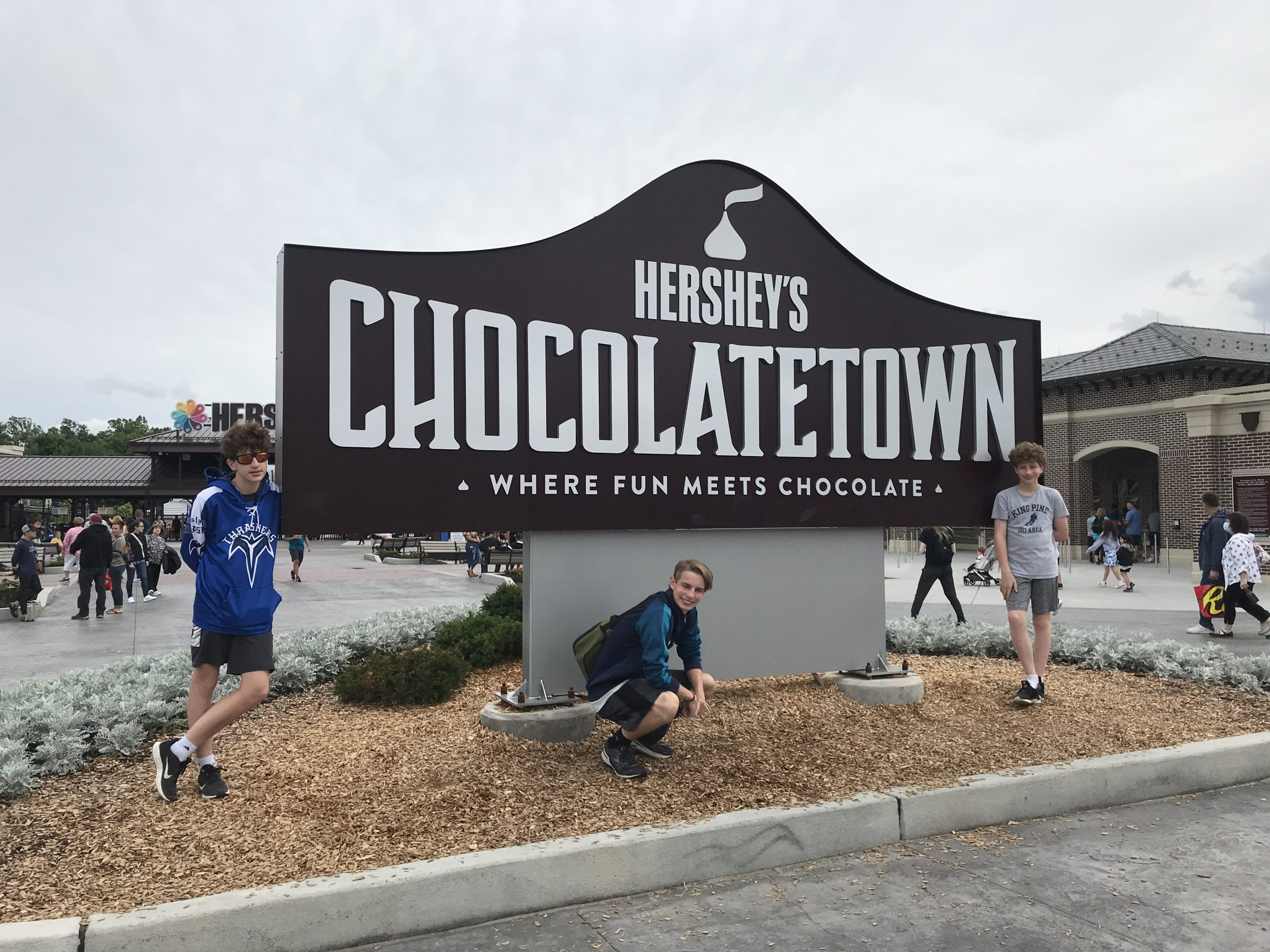 family picture in front of Hershey's Chocolatetown sign