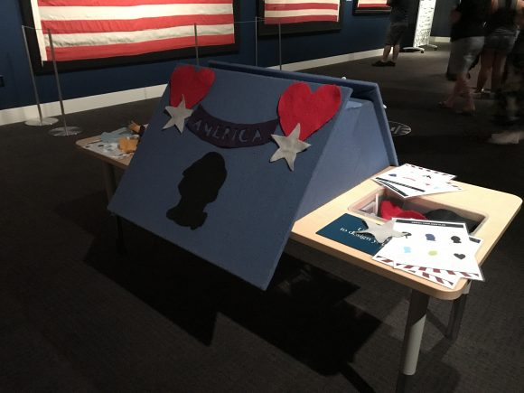 Design your own flag in the flag exhibit at Museum of the American Revolution.