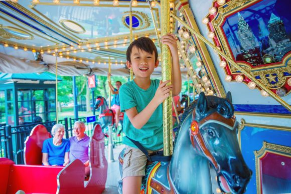 Franklin Square Carousel child with grandparents in background JeffFusco (1)
