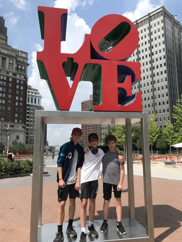 teen boys with Love statue in Philadelphia - Philadelphia staycation with kids